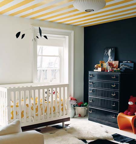 This nursery in the home of J.Crew's Creative Director Jenna Lyons, which was featured in Domino was painted with sunny yellow stripes on its ceiling. The pattern not only gives a baby something to look at, but it anchors the entire room. Source