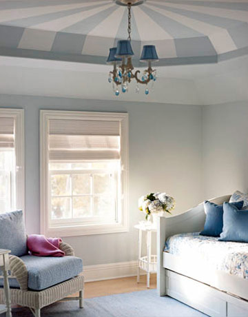 A young girl's bedroom in a Wisconsin cottage, which was featured in House Beautiful, has a tent-like painted ceiling. It has a fun circus effect, but the soft blue keeps it chic and not kitschy. Source