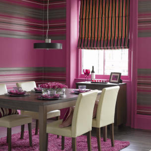 Things get busy on the striped walls of this dining room with varying widths, colors, and leading. Source