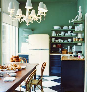This quaint kitchen, designed by Ruthie Sommers, is actually in the office of Drew Barrymore's production company, Flower Films. I love how it creates a country farmhouse vibe in the middle of Los Angeles, and that it's more home-chic than office bland. I also dig how painting the open shelving green makes the white elements pop! Source