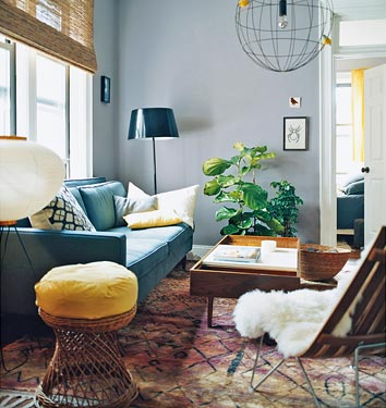 Besides being an amazing actress, Julianne Moore is also a talented decorator. She designed this room herself. I love her mix of thrift store finds, high-end pieces, and unique fixtures (she designed that wire globe fixture). Source