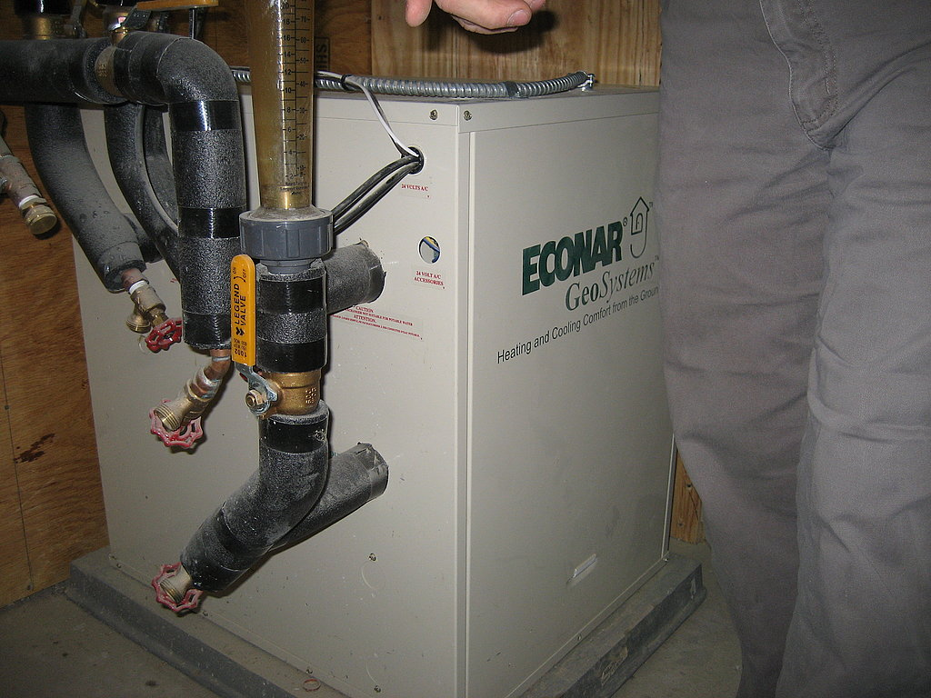 The Econar geothermal heat pump uses the relatively constant temperature of the ground several feet below the earth's surface as a source of heating and cooling.