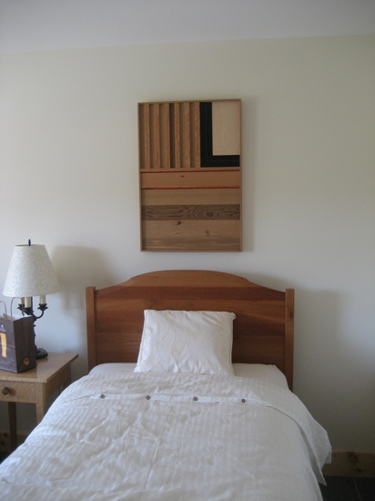 The bed frames were built by Pompanoosuc Mills, while the architect actually made this art piece from different wood samples.