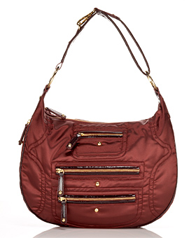 Guess Who Designed This Sporty Burgundy Bag?