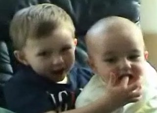 Baby Bites His Older Brother's Finger and Laughs