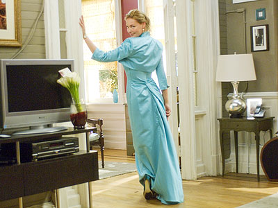 """TEAL AND SYMPATHY Thomas tried to work against Heigl's fair coloring with this blue-green dress. """"I thought, 'This is what a br"""