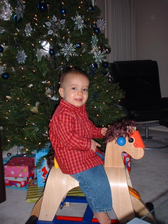 On his rocking horse during Christmas 2006